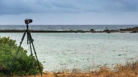 tomar : Camera taking picture film of sea coast time lapse Stock Footage