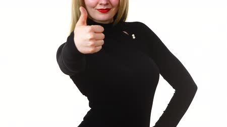 подтверждать : Woman making thumb up gesture