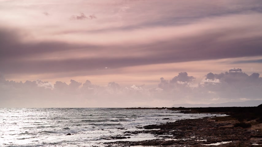 peloponnese : sunset over sea surface, dark rainy clouds Stock Footage