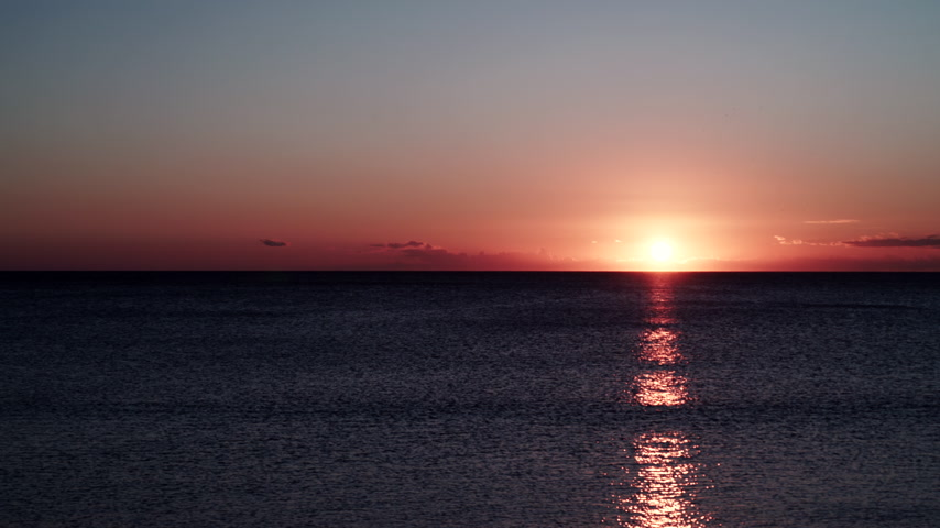 řek : Sunset over sea surface time lapse
