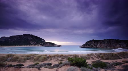 peloponnese : Greek Voidokilia beach and sky after sunset, time lapse