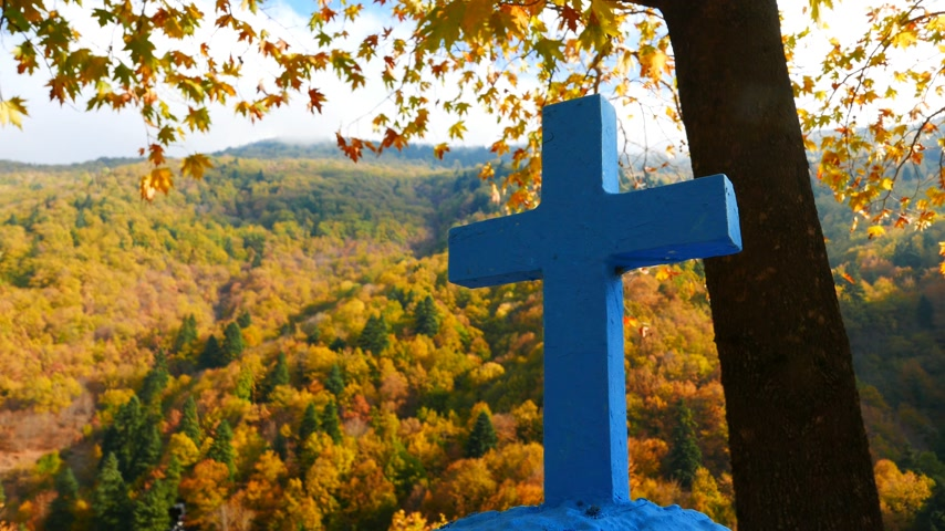 crucifix : Greek blue cross in autumn scenery 4K