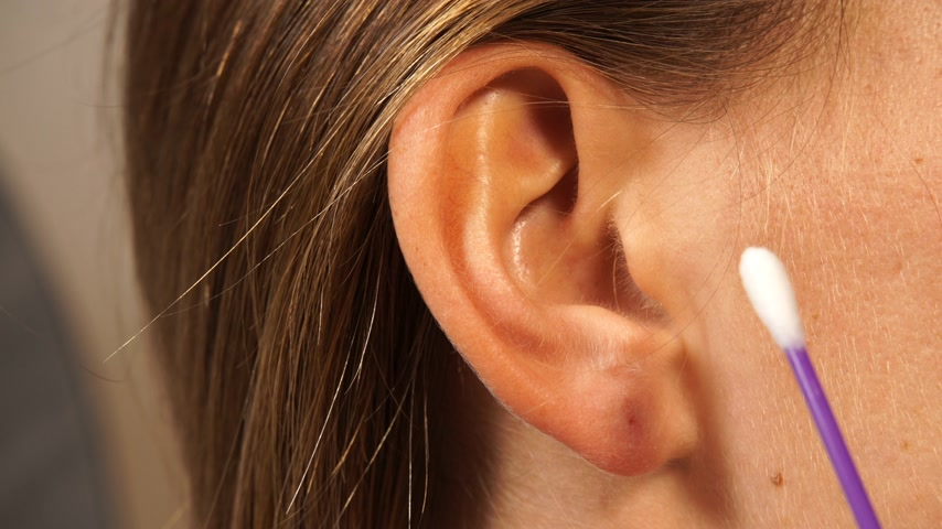 cotton swab : Woman cleaning ear with cotton swabs close up 4K ProRes HQ codec