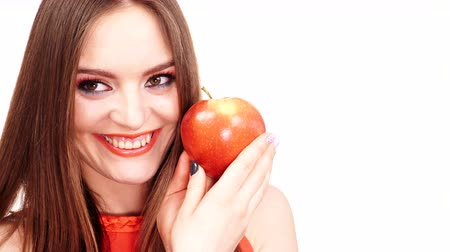 saçlı : Woman young charming female long-haired girl make up holds big red apple fruit. Healthy eating, vegetarian food, dieting and people concept. 4K ProRes HQ codec