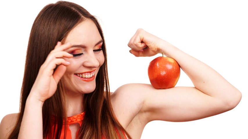 biceps : Young woman with long hair stock photography Young woman with long hair stock photography Healthy eating, vegetarian food, dieting and power concept. 4K ProRes HQ codec