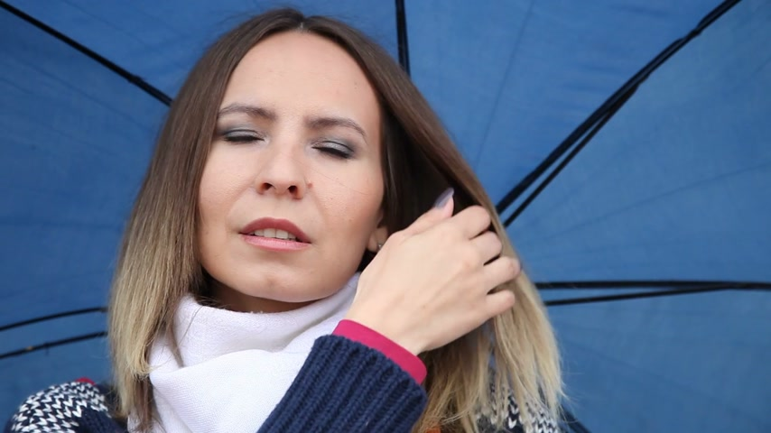 kívül : Smiling young woman with long hair smiling and winking on a rainy day. Outdoor. Weather.