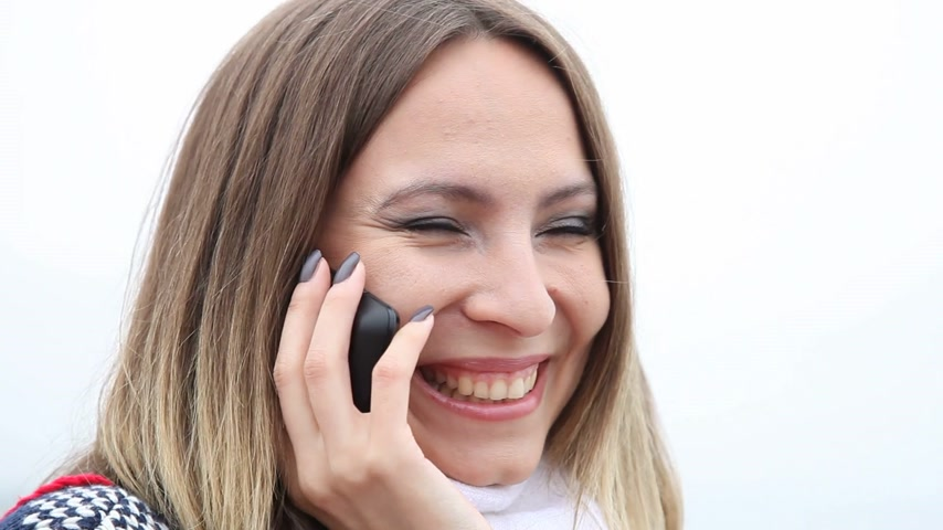 talc : Communication. Happy girl smiling woman talking on cell phone cellphone smartphone and showing ok okay success hand sign gesture outdoor. Good news.