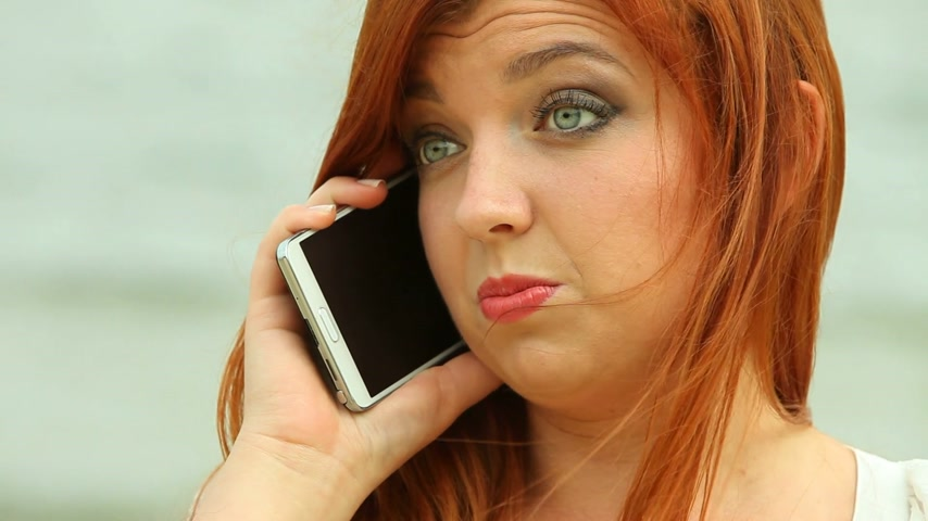 they : Woman speaking on the phone on beach Stock Footage