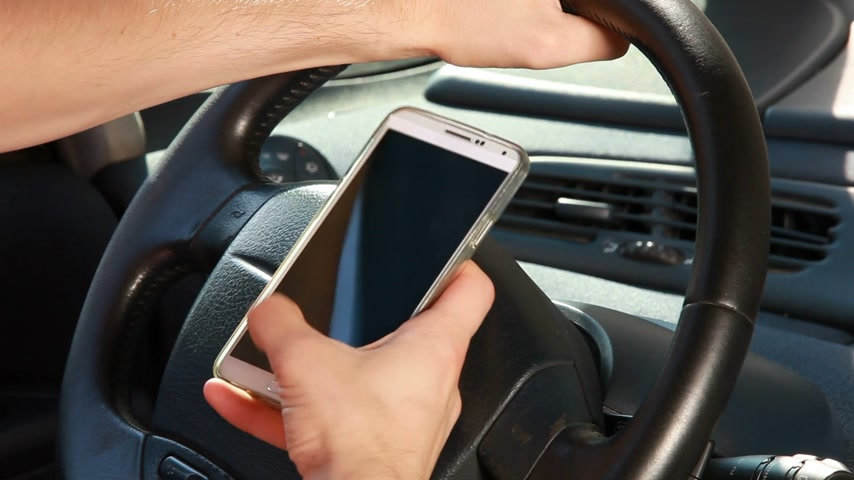 irresponsible : Texting with a smart phone in car