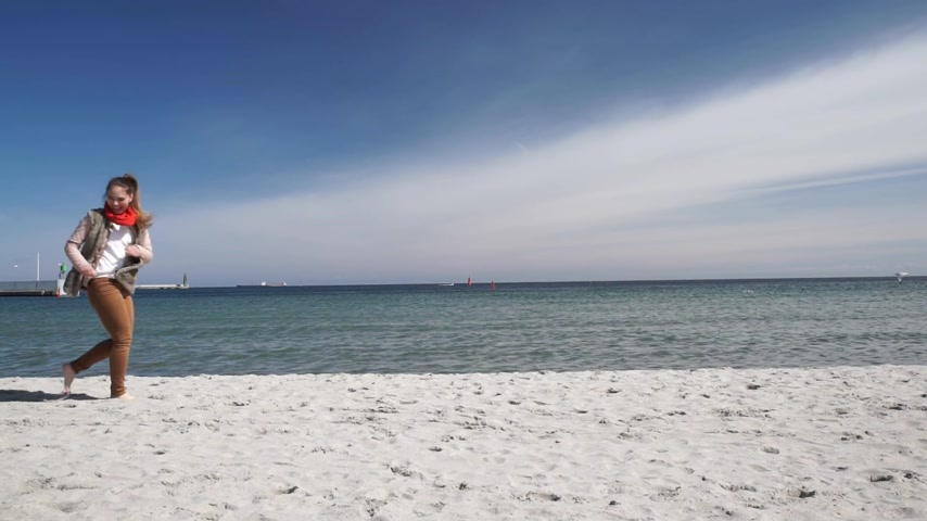 Happy young couple in love having fun on sunny beach. Woman and man enjoying love on date or honeymoon.