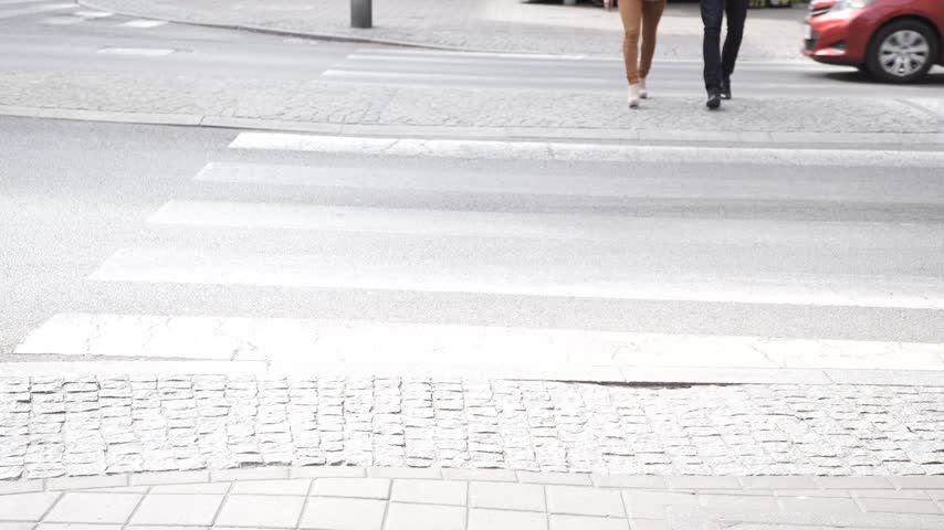 zebra : Couple walks hand in the street, woman and man crossing street zebra. Stock Footage