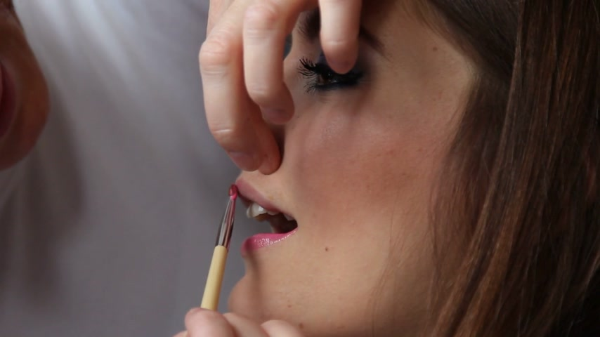 átalakítása : Cosmetic beauty procedures and makeover concept. Closeup woman face pink lips. Makeup artist applying lip gloss with brush accessories tools. Full HD 1920X1080P