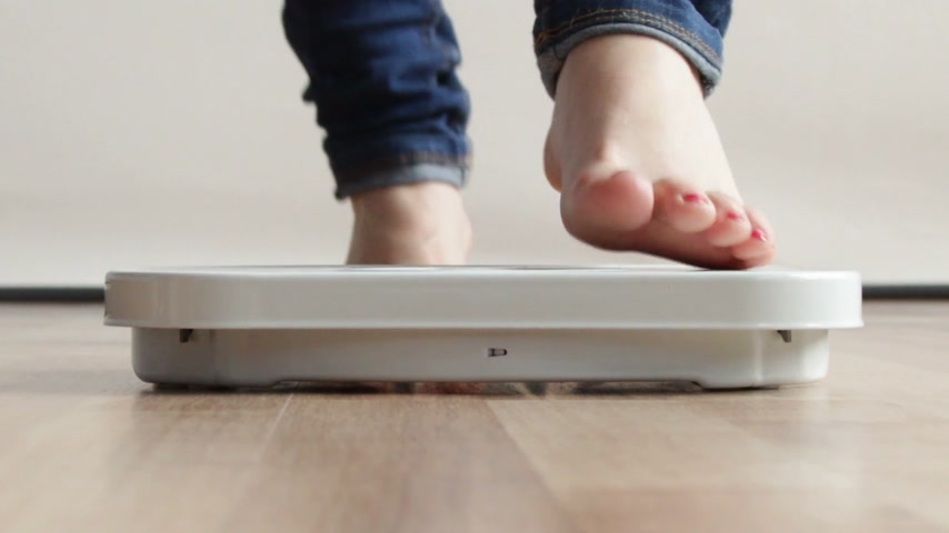 high calories : Diet slimming weight loss. Woman stepping on scales. Full HD 1920X1080P