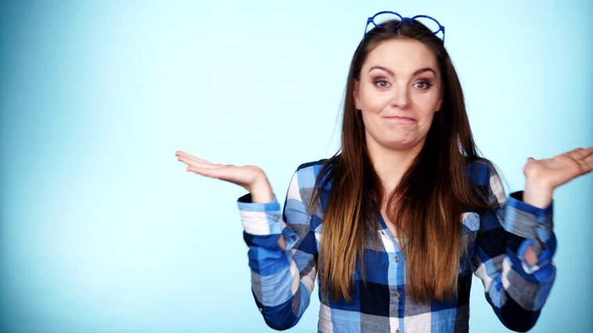 pateta : Woman having fun, making silly face fooling around dancing, joyful young female showing positive expression making thumb up hand gesture, studio shot blue wall background 4K