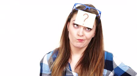 forget : Woman confused thinking seeks a solution, paper card with question mark on her head. Doubtful young female studio shot isolated on white background. 4K ProRes HQ codec Stock Footage