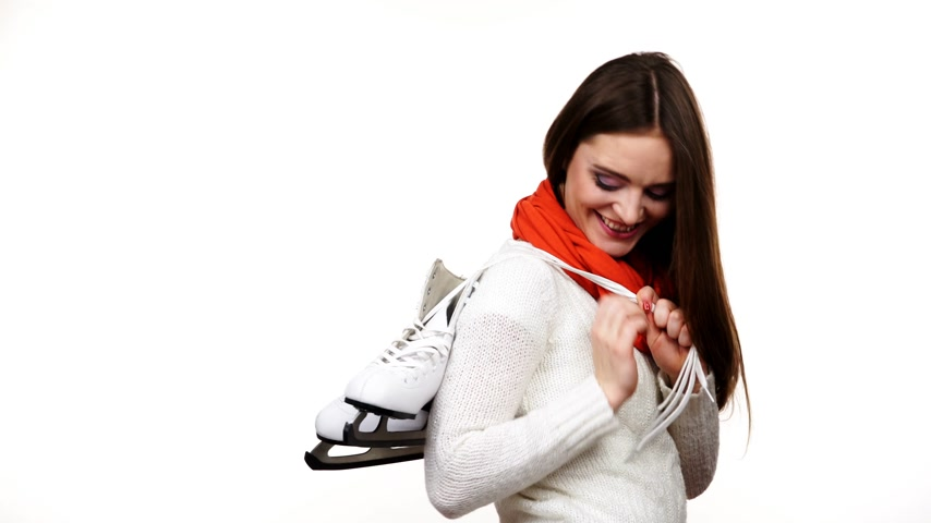 ice skating : Woman with ice skates getting ready for ice skating, winter sport activity. Smiling girl wearing warm clothing on white studio shot 4K ProRes HQ codec Stock Footage