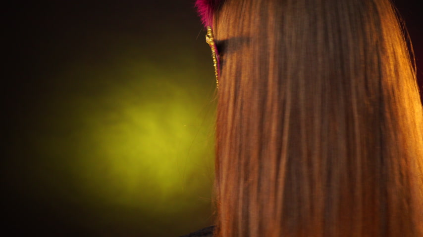 ziyafet : Woman face with carnival mask on festive colorful dark background. Party new year celebration concept. 4K ProRes HQ codec