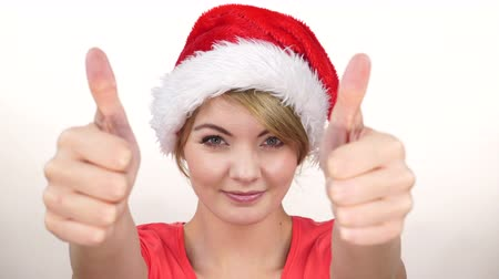 kciuk : Woman in santa claus helper hat giving thumb up gesture. Happy smiling girl blinking winking. 4K ProRes HQ codec,