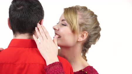 Couple. Woman telling man some secrets, gossiping. Smiling girl whispering good news to boyfriend ear hugging her partner. 4K ProRes HQ codec Stock Footage