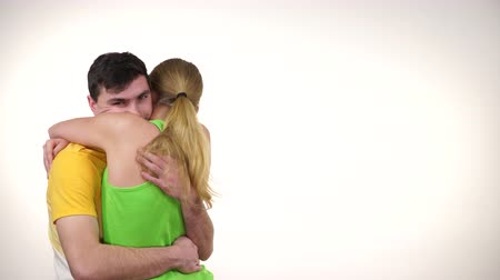 Couple fit healthy woman and man hugging. Active people sport and success concept.4K ProRes HQ codec
