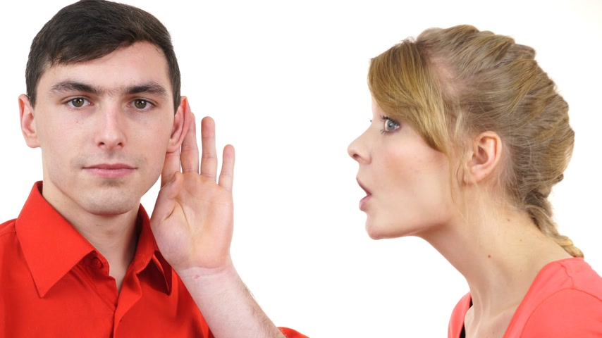 Woman telling man some secrets, couple talking gossiping. Excited emotional girl whispering to boyfriend ear. 4K ProRes HQ codec