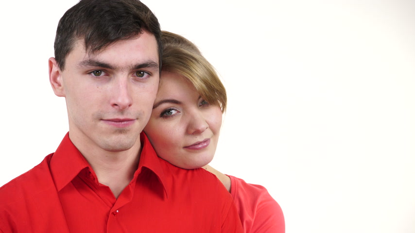 Couple lovers wearing red clothes on date. Woman lean on man on shoulder romantically. Quiet peaceful atmosphere. Romantic relationships. Family and love. 4K ProRes HQ codec Стоковые видеозаписи