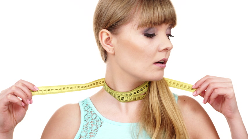 obsession : Woman fit girl with measuring tape tight around her neck. Diet weight loss and slim body concept. 4K ProRes HQ codec Stock Footage