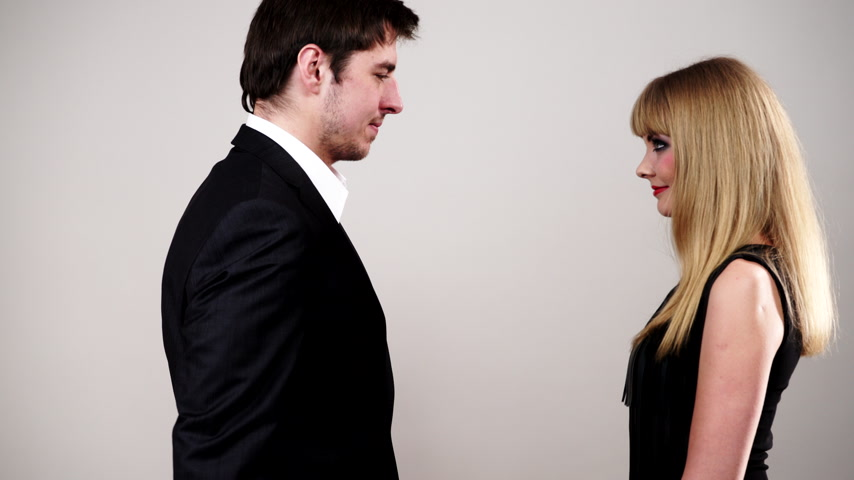 proposition : Couple in love. Man giving woman red rose flower. Blonde lady makeup evening dress and handsome man wearing suit studio shot, Dating, celebrating valentine day concept 4K ProRes HQ codec