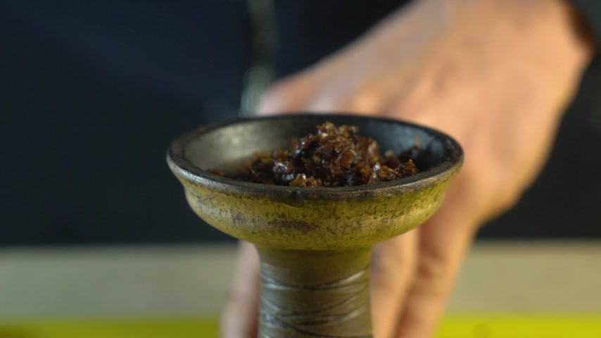 alumínium : Tobacco for hookah poured into the bowl in slow motion