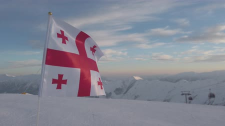 zanedbaný : Georgian flag on snowy mountains, Gudauri, Georgia, 4k