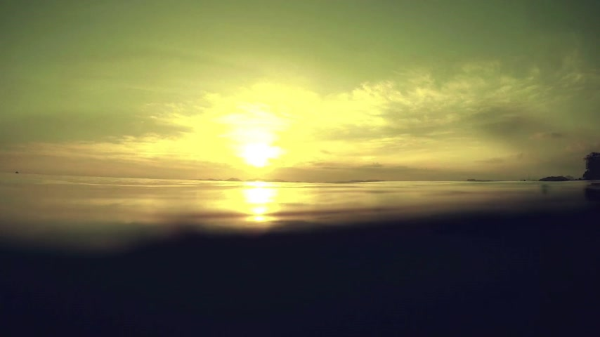 serene : Calm sea surface from underwater at sunset Stock Footage
