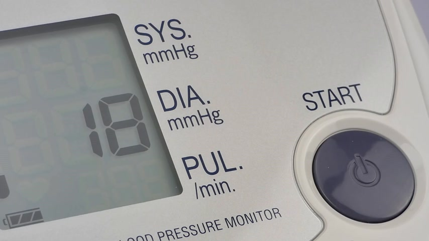 hypertension : modern household digital blood pressure monitor, closeup