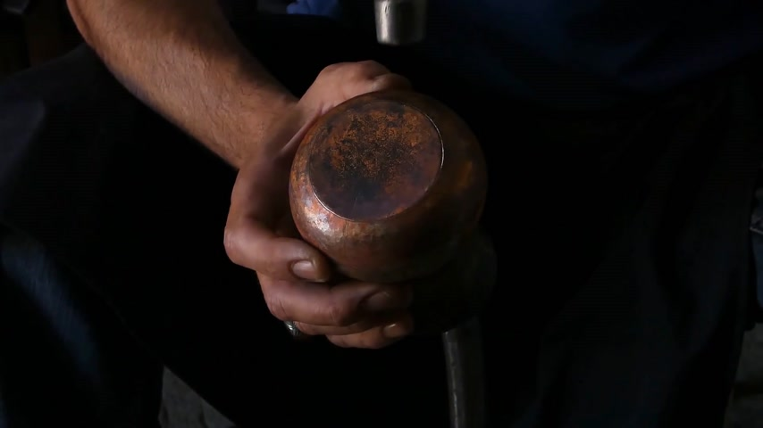 coppersmith : a master blacksmith produces the jug from copper. masters of Central Asia and Uzbekistan. hand-minting copper. the ancient art of making crockery