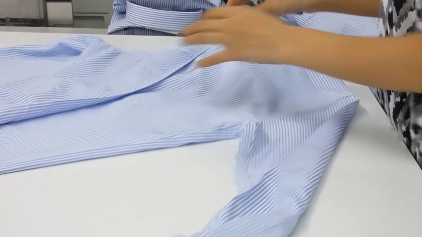 acabado : seamstress in the sewing shop. a textile factory worker with a pair of scissors removes the unnecessary threads and defects from clothing