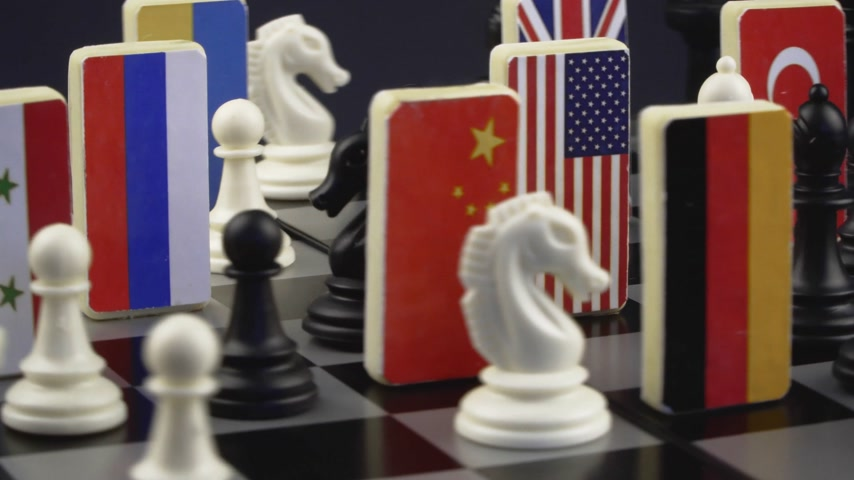 politicians : Symbols of the flags of the world on the chessboard. The concept of political game.