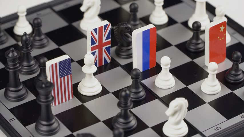 politicians : Politicians hand moves a chess piece with a flag. Conceptual photo of a political game. Retaliatory move Russia