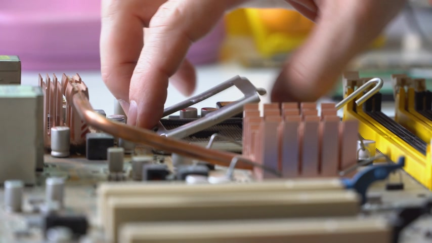 микрочип : electronic technician assemble motherboard. PC repair. Install processor