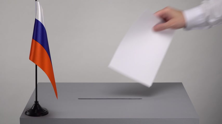 Ballot box with the national flag of Russia. Presidential and parliamentary elections. The voter throws the ballot box in the ballot box.