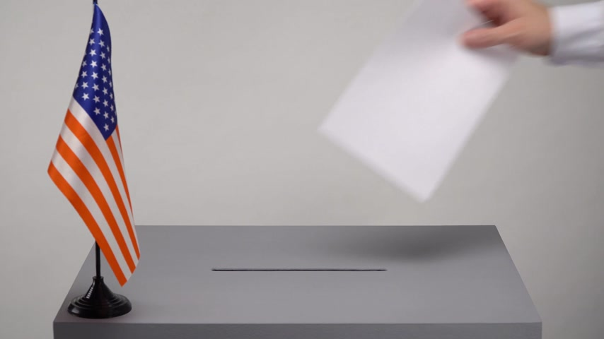 president of united states : Ballot box with the national flag of USA. Presidential and parliamentary elections. The voter throws the ballot box in the ballot box.