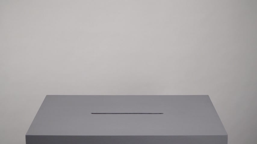 Gray ballot box. Presidential and parliamentary elections. The voter throws the ballot into the ballot box. 動画素材