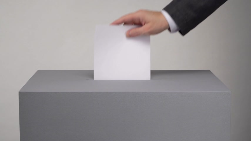 Gray ballot box. Presidential and parliamentary elections. The voter throws the ballot into the ballot box. Stok Video