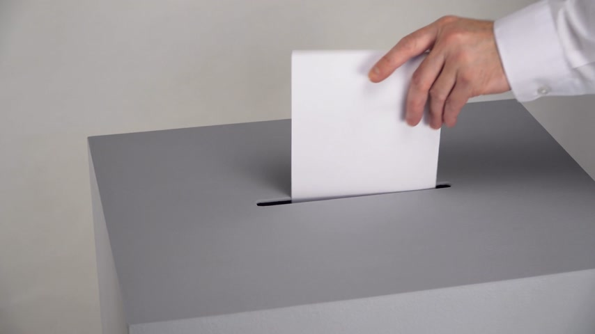election campaign : Gray ballot box. Presidential and parliamentary elections. The voter throws the ballot into the ballot box. Stock Footage
