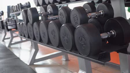 rack focus : row of dumbbells in a modern gym Stock Footage