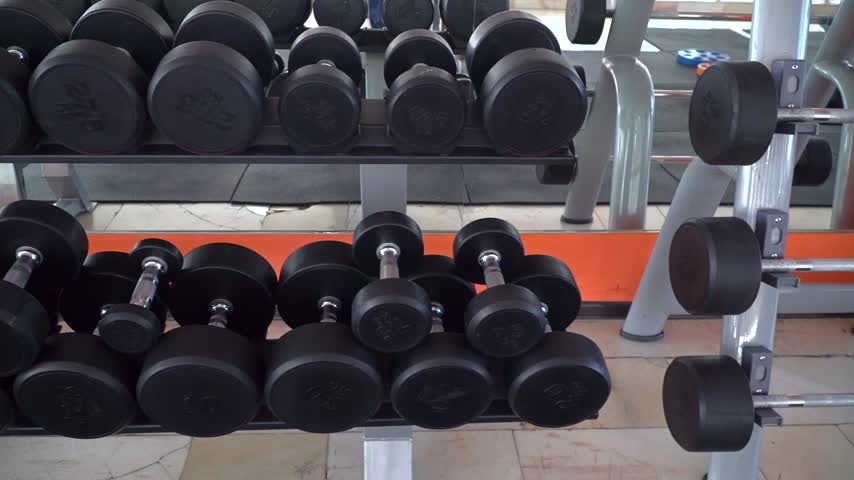 row of dumbbells in a modern gym Stok Video