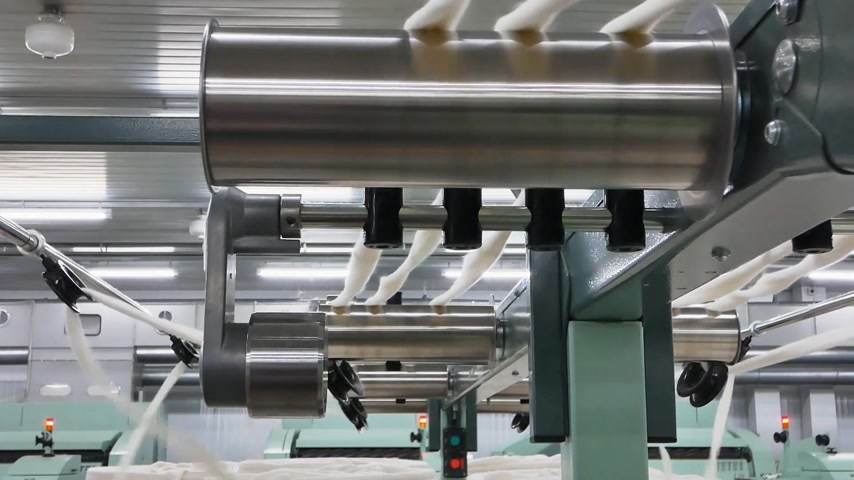 Machinery and equipment in the workshop for the production of thread. Roller mechanism in textile factory. Stok Video