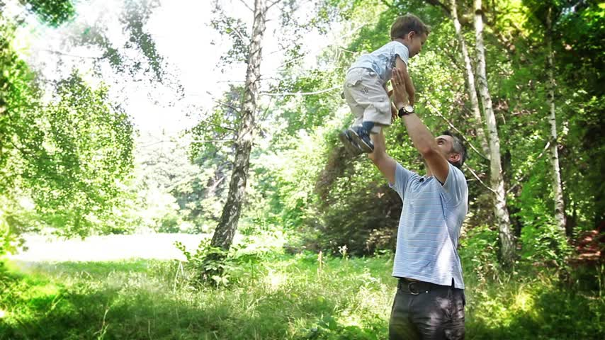 family life : Adorable Baby Boy and Father in Park