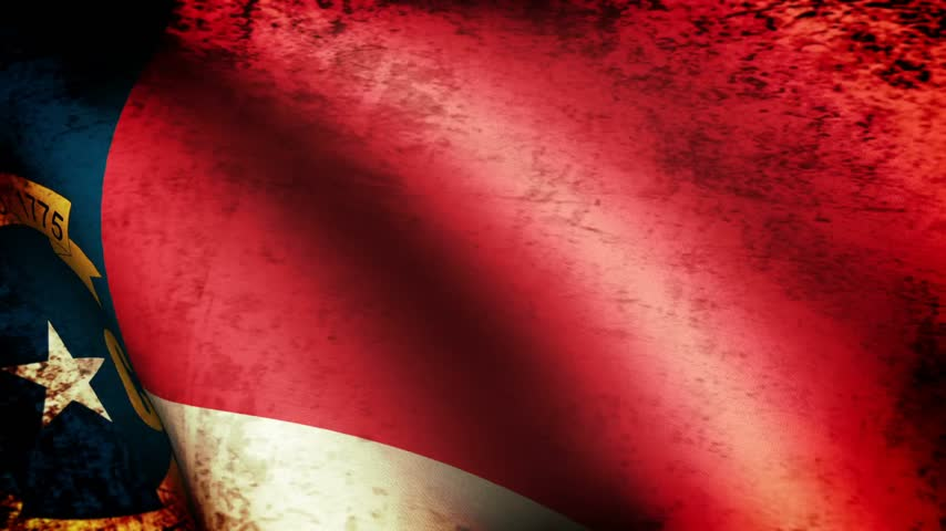 north america : North Carolina State Flag Waving, grunge look Stock Footage