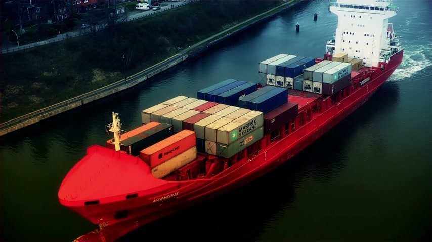 shipping : Cargo ship filled with containers passing
