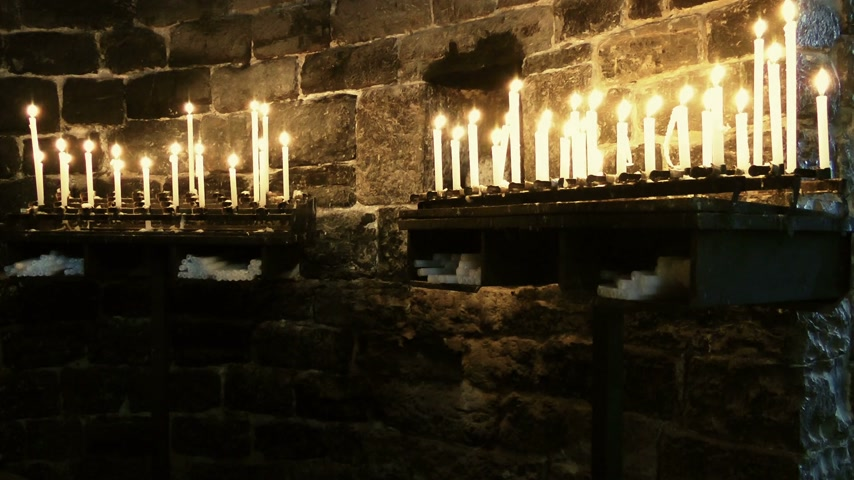 duch Święty : Burning candles in Church of Saint Peter, Portovenere