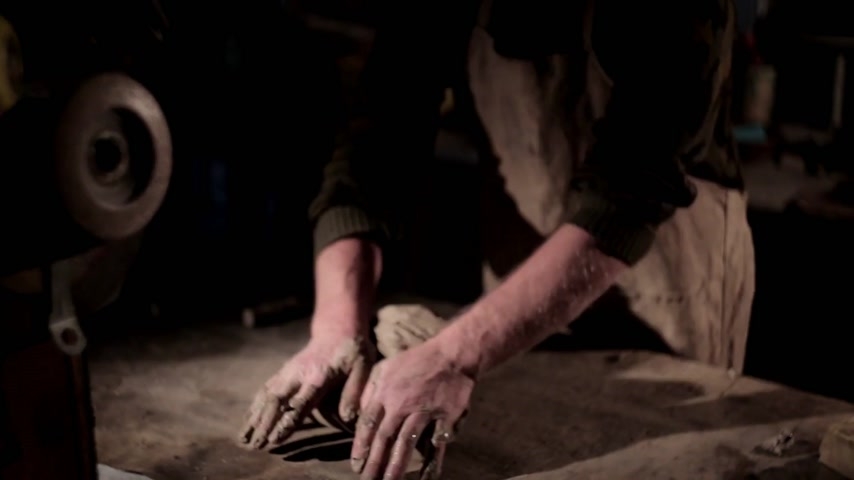 fingertips : Adult male potter master preparing the clay on table. Front view, closeup, hands only, unrecognizable.